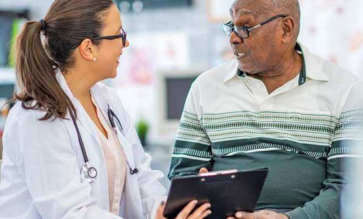 Adult-Gerontology Nurse Practitioner helping a senior in long term care